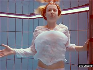 lovely ginger-haired plays naked underwater