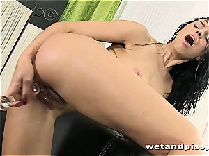 huge-boobed Elena Rae pees thru her stockings
