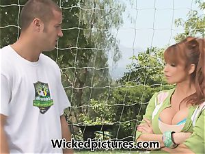 Caring mom Taylor Wane pokes her son's soccer coach