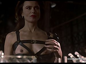 dark haired Lena Olin in undergarments demonstrates off her smallish globes
