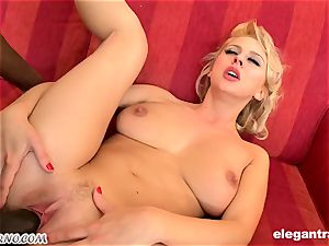 lovable platinum-blonde Mandy Dee riding black schlong