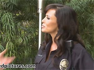buxomy cop Lisa Ann gives out her fuckpole punishment
